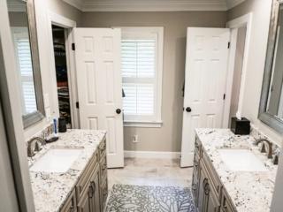 Dual Bathroom Vanities With Granite Counter Tops and Tile Flooring, Apex NC.