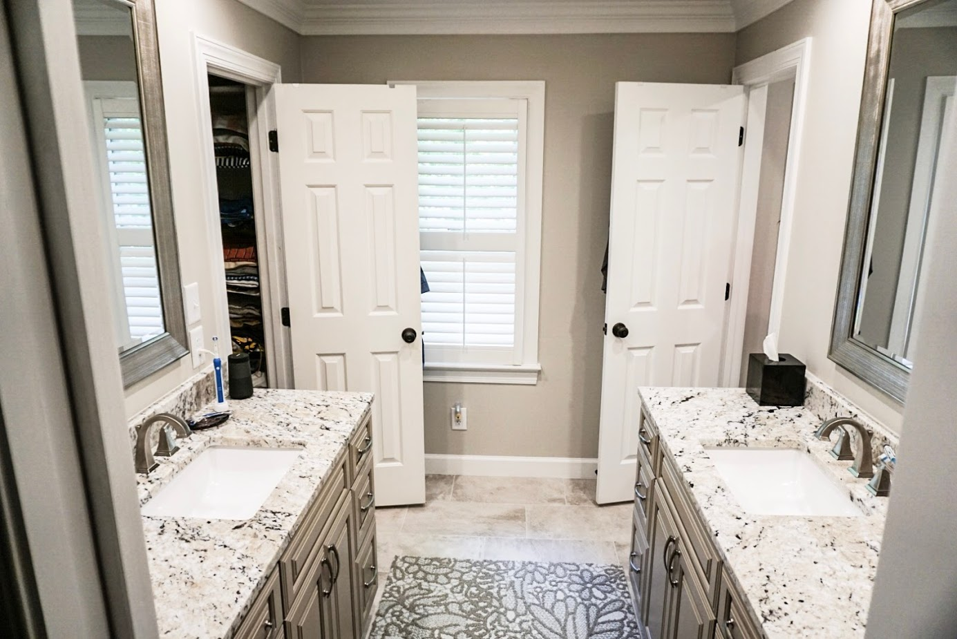 Dual Bathroom Vanities With Granite Counter Tops and Tile Flooring, Apex NC.